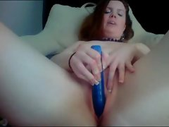 Naughty talking redhead with her vibrator