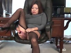 Asian in sweaterdress has dildo sex