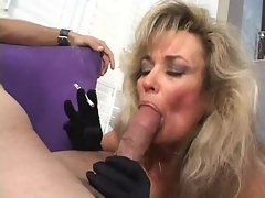 Mature in black gloves blows and smokes