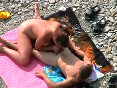 Voyeur clip of couple fucking on beach