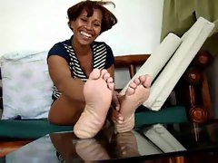 Black chick showing us her feet