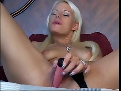 Hot blonde smokes cigarette while masturbating