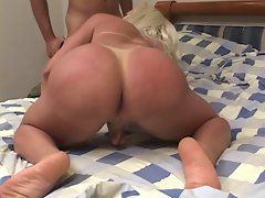 Two whores share and suck on a big black cock in bedroom