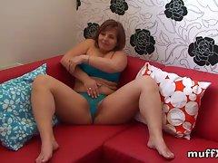 Marie Jeanne masturbates on red sofa