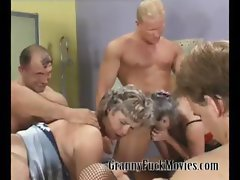 Grandma in hardcore group sex party