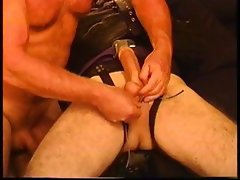Strait jacketed bondage and CBT with huge hung bottom boy.