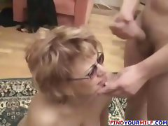 Mature blonde mom gets seduced by two young studs and gets nailed