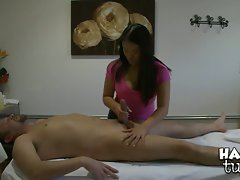 Message therapist Kiwi Ling oils up cock and gives it a good hard tug