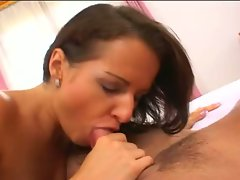Luisa De Marco on her kness with a mouth full of cock and another up her snatch