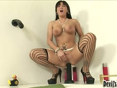 Lovely naked Claire Dames pacifies her cock craving hole on a huge toy cock