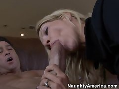 Cougar Emma Starr gives a stellar performance sucking a young cock