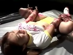 Jap whore gets hot wax over her body from her master