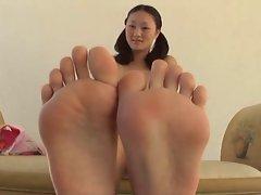 Evelyn Lin gives a footjob