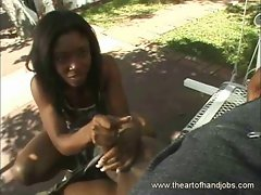 African babe on an outdoor handjob