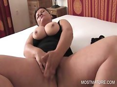 Busty mature rubbing pussy