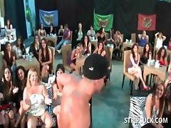 Sluts sucking stripper's shaft at orgy