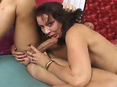 Milf in stockings gets nailed on couch
