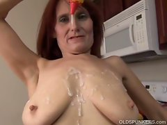Nasty granny stuffs pussy with banana in the kitchen