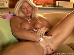 Blonde granny with big tits masturbates