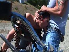 Cock sucking brunette biker gets ass fucked