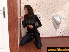 Tall brunette gets cum shower at a gloryhole