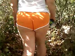 Wife Walking through the Woods Outside