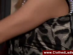 Two clothed ladies making out