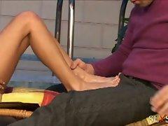 Slender blonde slut using feet and mouth on hard cock