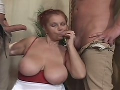 Granny in red is a whore for two young huge boners