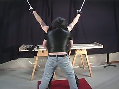 Dude with his arms tied gets his butt whiped and spanked