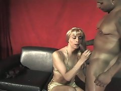 Latino shemale takes black cock in mouth and ass