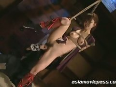 Japanese babe tied up and abused as she gets fucked