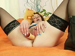Mature milf toys her big wet cunt