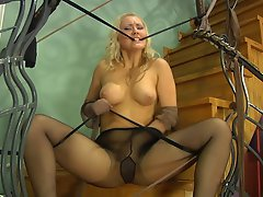 Kinky babe in control top hose grinds her pussy against stretched...