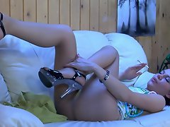Cute gal in high-heeled sandals enjoys the feel of her smooth tan...