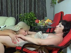 Horny babe fits a strap-on for dirty fucking games with a lewd mature...