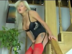Curvy blondie in red stockings craves to get new sensations on the...