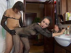 Teasing chick in a see-thru bodystocking luring her guy into...