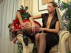 Cute sissy clad in a pretty French maid outfit gets dildo fucked by a...