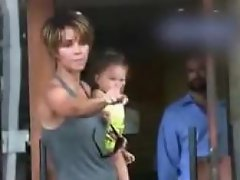 Halle Berry gets angry with the paparazzis as they continue to take...