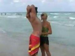 Paris Hilton caught by paparazzis enjoying the beach with a guy that...