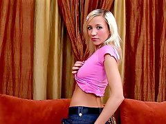 Seductive blonde teenage angel Feona stripping jeans and teasing with...