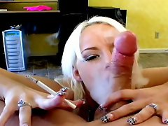 Superb blonde smoker tramp Angel Couture sucking a massive penis on...