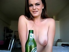 Naked brunette exgirlfriend babe Ariel sucking a beer bottle with lust...
