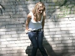 Fair gal shows off while peeing outdoors...