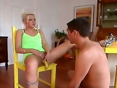 See this horny blond chick as she crawls on the floor and begs for a...