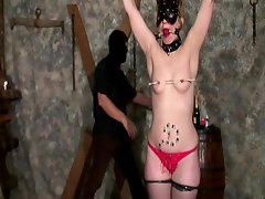 This daring whore is helplessly tied on a wooden cross while this...