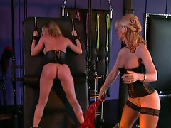 This daring whore is helplessly tied on a wall while this nasty old...