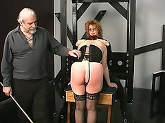 Mature vixen, her hands locked at her back, forbidding movement,...