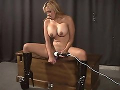 This horny blonde slut uses her vibrator while her dude lies on the...